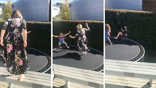 Hilarious video shows over enthusiastic mum bouncing off trampoline into a bush - Video