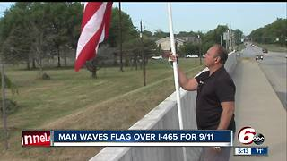 Indianapolis man waves flag over I-465 for 9/11 - Video