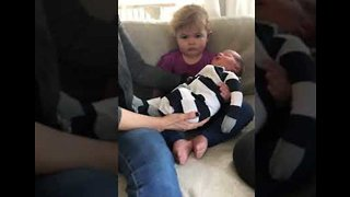Toddler Is Hilariously Unimpressed By New Baby Brother - Video