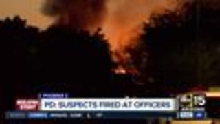Shots heard, flames seen during Phoenix standoff with armed robbery suspects