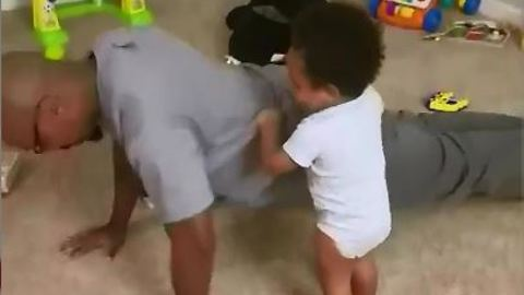 Baby Fitness Coach Makes Sure Dad Does His Push-Ups Right