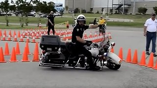 Cop Shows Off His Motorbike Skills - Video
