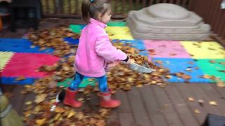 A Tot Girl Fails At Sweeping Leaves Off A Porch