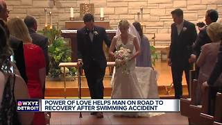 Paralyzed man walks down the aisle on wedding day after being told he may never walk again
