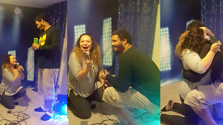 Girlfriend surprising boyfriend with proposal shocked when he gets down on one knee at same time - Video