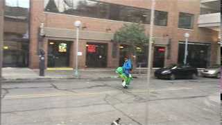 Man Rides Dinosaur to Work - Video