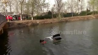 Firefighters save woman trapped in car that falls into lake
