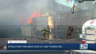 Firefighters battle 2-alarm fire that destroyed flower shop