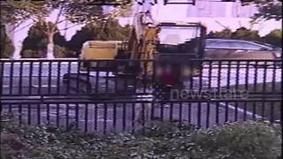 Schoolboy hijacks digger, knocks down iron gate - Video