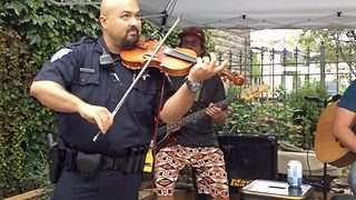 Policeman on the fiddle: Incredible moment cop steps on stage and blows bar away with impromptu violin performance - Video