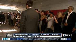 More than 100 men greeted students at Kelley Elementary - Video