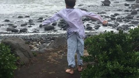 Boy Struggles Against Ex-Cyclone Gita Winds on New Zealand's North Island