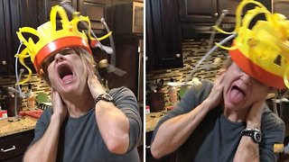 Hilarious video of woman trying to eat treats dangling from crown goes viral - Video