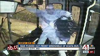 Video shows man pushed through city bus window - Video