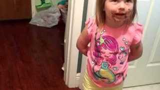 Child With Chocolate-Covered Face Denies Eating Cake