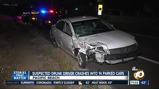 Suspected drunk driver hits 14 parked cars