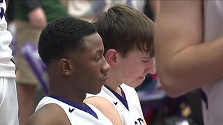 Barberton High School basketball player sits during national anthem for religious beliefs
