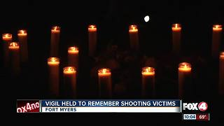 Vigil held to remember shooting victims - Video