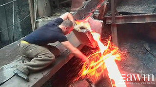 On A Bet Worker Sticks His Hand Into A Spout Of Molten Metal - Video