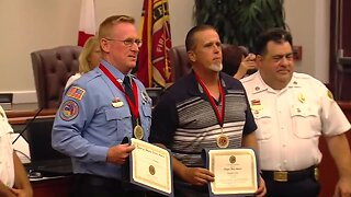 Courageous civilian, firefighter honored for rescuing woman from burning truck