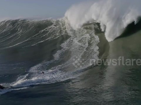 Wipe out! Surfer is engulfed by monster wave off coast of Portugal