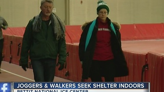 Joggers and walkers seek shelter indoors - Video