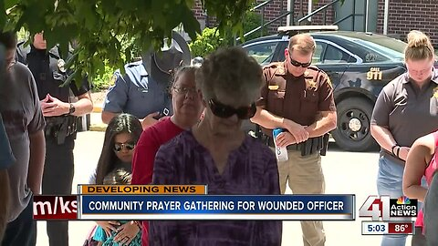 Community prayer gathering for wounded officer