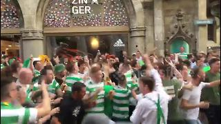 Lederhosen-clad Celtic fans drink beer in Munich ahead of Champions League clash - Video