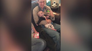 Funny Baby Girl Gets Curious About Her Dad's Phone - Video