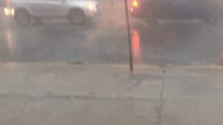 Debris Flies Through Montreal Street During Microburst - Video
