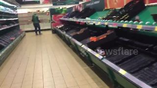 Shoppers empty supermarket shelves ahead of Storm Emma - Video