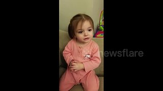 Angelic toddler does magic trick with pacifier
