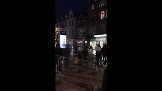 Police escort citizen from St. Mary's Street cordon in Cardiff during 'ongoing incident' - Video