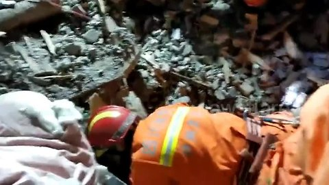 Three houses buried and four killed in massive Chinese landslide