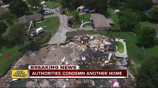 Seventh home condemned due to Florida sinkhole - Video