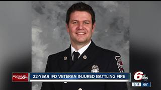 Indianapolis firefighter injured while battling fire - Video