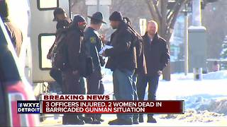 3 Detroit police officers shot, two women killed after barricaded gunman situation - Video