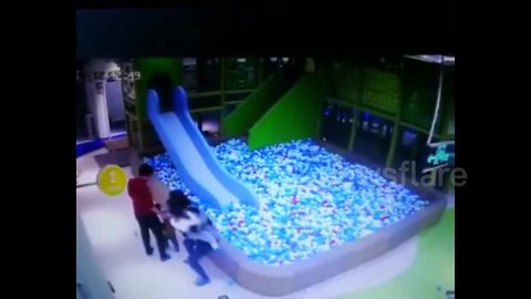 Angry woman throws little girl into ball pit after girl got into fight with her son