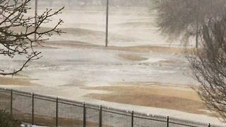 Floodwaters Flow Through Mansfield Country Club