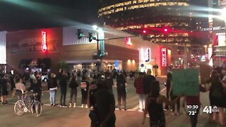 Protesters march through KC