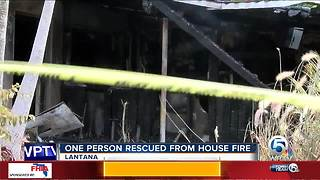 One person rescued from house fire in Lantana