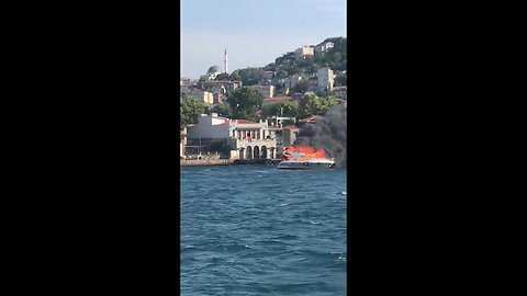 A yacht in flames on the Bosphorus in Istanbul, Turkey