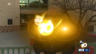 Rally for embattled principal - Video