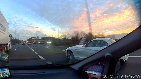 Careless driver appears to be watching video at 70 mph on the motorway