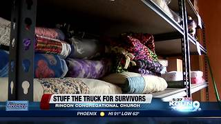 Stuff the truck event collects goods for domestic violence victims - Video
