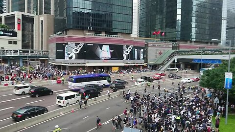 Protesters block Harcourt road in central Hong Kong