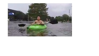 People Navigate Houston Floods in Kayaks - Video