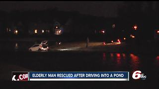Elderly man drives car into freezing water of a retention pond - Video