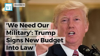 'We Need Our Military' Trump Signs New Budget Into Law - Video