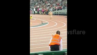 Security remove streaker from London Athletics World Championship - Video